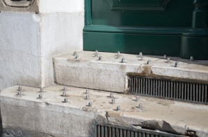 Spikes in front of doors are among a number of architectural street strategies used to deter homeless people. (copyright by Survival Group)