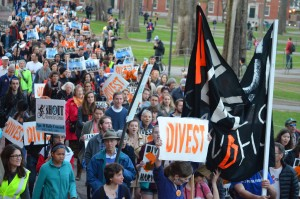 Protestors calling for Harvard to divest from fossil-fuels during Heat Week, April 2015. Looking at moments of contestation in the climate crisis reveals much about the broader political, economic, and social terrains in which the alleged contradictions are embedded.